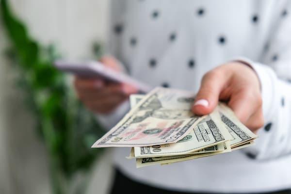 Woman handing money.